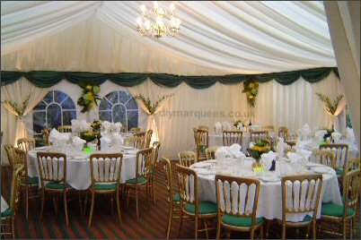 9m wide marquee with pleated lining & green swag