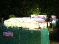 Several DIY Marquees used as changing areas and covers for seating around an open air theatre