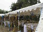 A DIY Marquee used as a roof only cover for a wedding